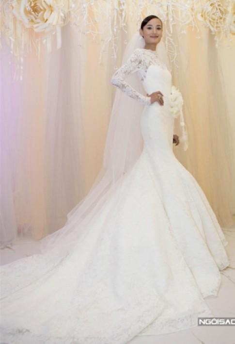 Lê Thúy, Tâm Tít mặc đẹp nhất tuần với váy cưới kín đáo