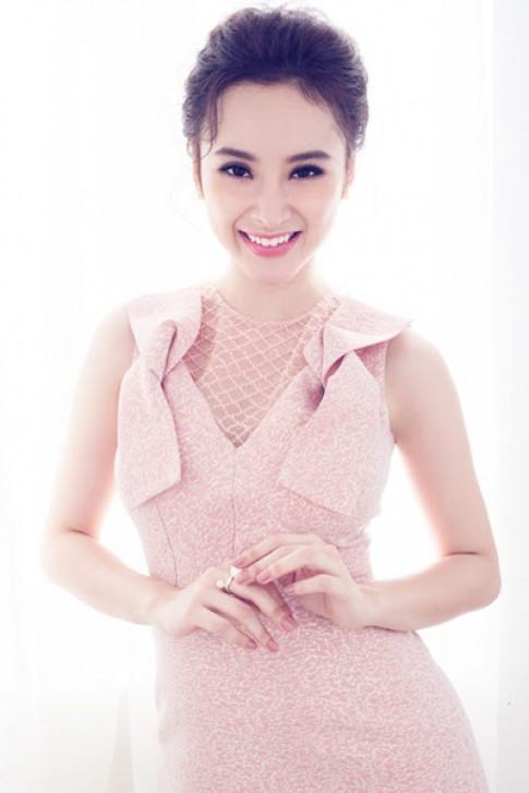 Angela Phương Trinh hóa quý cô với đầm hồng thạch anh