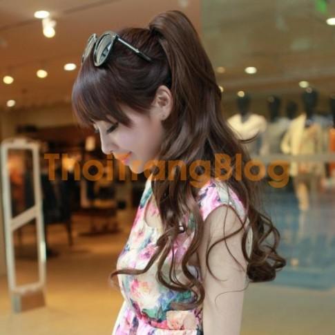 Những kiểu tóc xoăn buộc cao đẹp cho nàng năng động hè 2016 mát mẻ