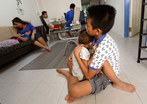 """Cậu bé Malaysia 12 tuổi làm """"cha"""" của 4 đứa trẻ"""